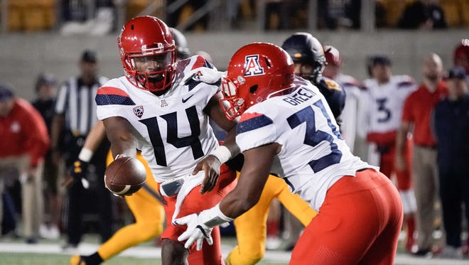 Oct 21, 2017: Arizona Wildcats quarterback Khalil Tate (14) hands the ball off to running back Zach Green (34) in the game against the California Golden Bears during the fourth quarter at Memorial Stadium.