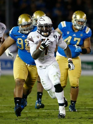 ASU 's Marion Grice runs for a first down against UCLA during PAC-12 action on Saturday, Nov. 23, 2013 in Pasadena, Calif.