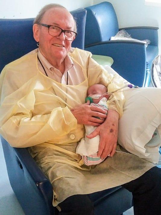 David holding Logan