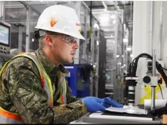 Battery plant worker