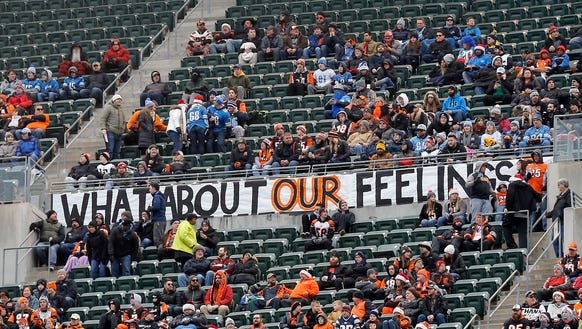 Fans hang a sign during the first quarter of the NFL