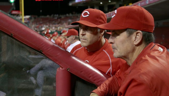 Cincinnati Reds manager Bryan Price (38) and hitting coach Don Long look on as Joey Votto bats in the bottom of the eighth inning of the MLB Interleague game between the Cincinnati Reds and the Cleveland Indians at Great American Ball Park in downtown Cincinnati on Thursday, May 19, 2016. The Reds lost 7-2, falling to 15-26 on the season.