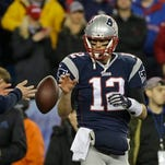 In this Jan. 18, 2015, file photo, New England Patriots quarterback Tom Brady has a ball tossed to him during warmups before the NFL football AFC Championship game against the Indianapolis Colts in Foxborough, Mass. Brady's four-game suspension for his role in using underinflated footballs during the AFC championship game last season has been upheld by NFL Commissioner Roger Goodell. The league announced the decision Tuesday.