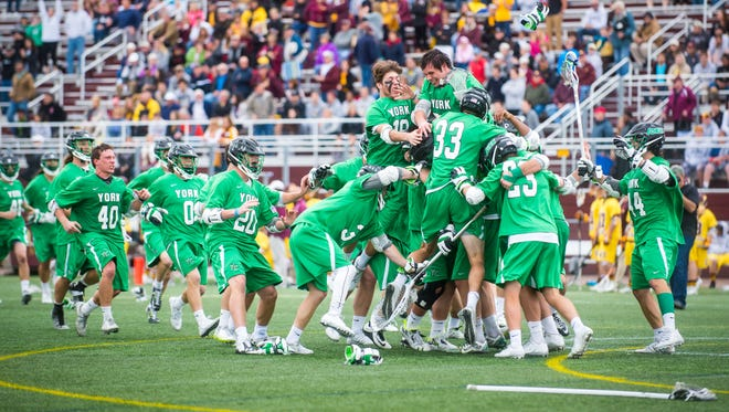 York College celebrates after beating Salisbury University, 10-9, to win the Spartans' first Capital Athletic Conference championship on April 30 at Seagull Stadium in Salisbury, Md.