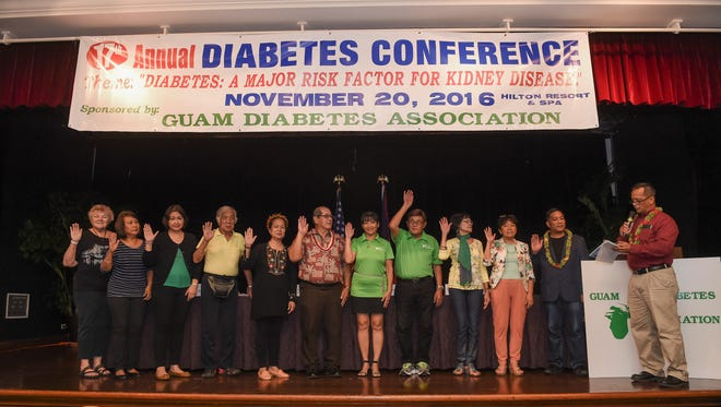 Sen. Frank Aguon, Jr. inducts the 2016-17 Guam Diabetes Association officers during the 17th Annual Diabetes Conference at Guam Hilton Resort and Spa in Tumon on Nov. 20, 2016.