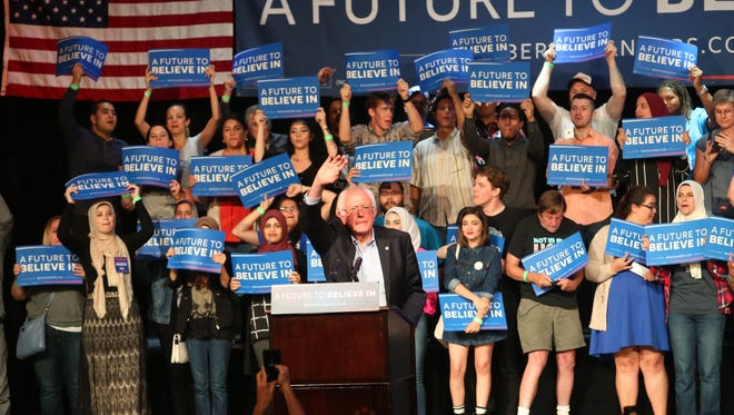 Bernie Sanders greets the crowd at the Riverside Municipal Auditorium on Tuesday, May 24.