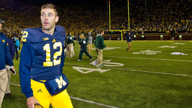 Blake O'Neill walks off the field after Saturday's game at Michigan Stadium.