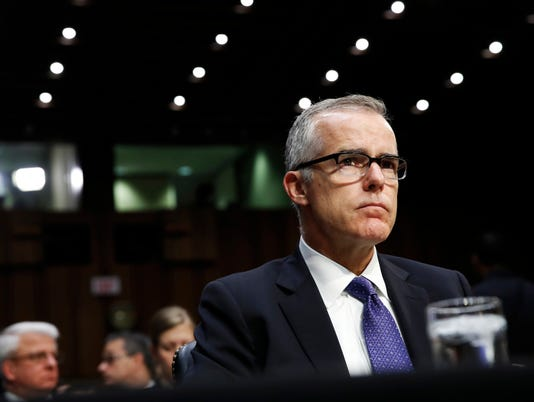 Acting FBI Director Andrew McCabe listens on Capitol Hill in Washington