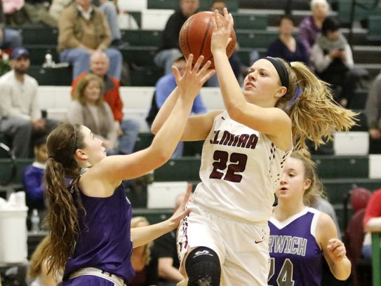 Alexus Boorse of Elmira goes up for a shot as Taylor