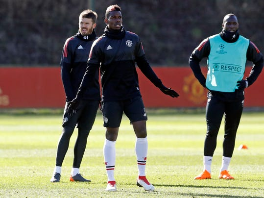 Manchester United's Paul Pogba, foreground center, attends a training session ahead of Wednesday's Champions League, round of 16 first-leg soccer match against Sevilla, at the AON Training Complex, Carrington, England, Tuesday, Feb. 20, 2018.  (Martin Rickett/PA via AP)