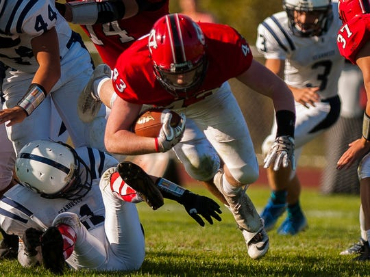 CVU #43 Jack ZuWallack dives through the BHS defense during their football match up in Hinesburg on Friday, Sept. 29, 2017. BHS won 27-7.
