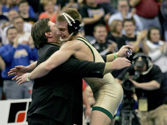 2010: Nick Moore, of Iowa City West, leaps into the