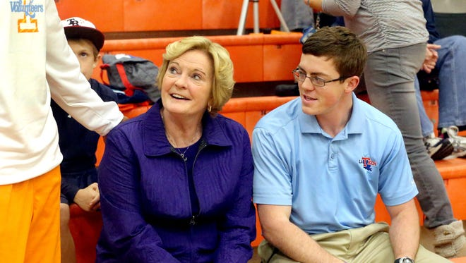 Lady Vols coach emeritus Pat Summitt, center, and son Tyler were both in the Midstate in mid-December for Blackman's We Back Pat Showcase, a high school girls basketball tournament that benefited The Pat Summitt Foundation.
