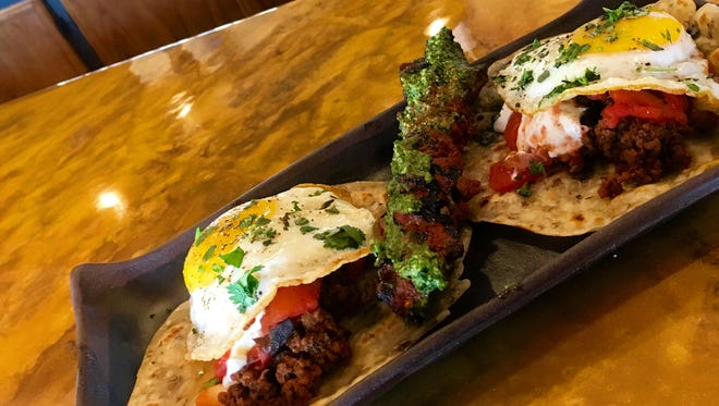 Helio Basin Brewing Co. chorizo tortillas with roasted tomatos, crema agria (sour cream) and sunny-side up eggs.