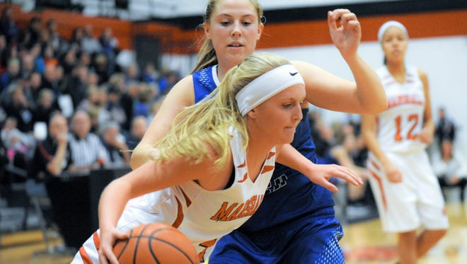 Marshall's Taylor Horn drives the basket Friday night.