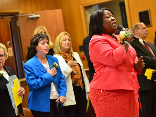 Deborah Keeling Geddis sings the national anthem at the Hackensack Reorganization Meeting on July 1, 2013, where Labrosse's Citizens For Change slate were sworn into office.