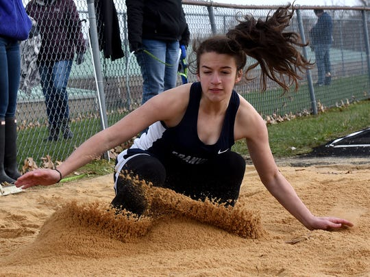 Granville's Lainie Hilaman competes in the long jump on Thursday night during the Dick Houston Relays at Licking Valley High School. Hilaman placed second in the event behind teammate Gracie Dennison.