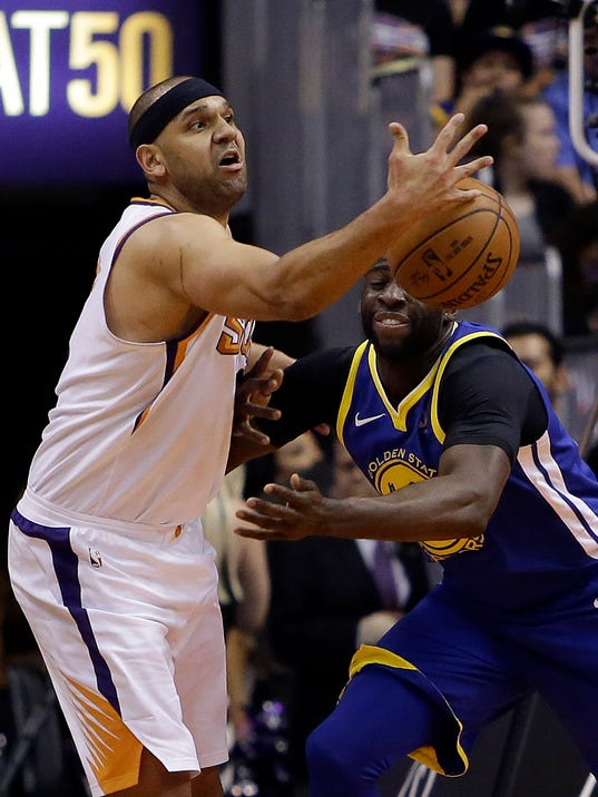 Phoenix Suns forward Jared Dudley, left, and Golden State Warriors forward Draymond Green battle for a loose ball in the first half during an NBA basketball game, Sunday, April 8, 2018, in Phoenix. (AP Photo/Rick Scuteri)