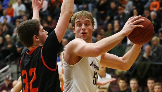 No.4 Dowling Catholic's Ted Brown, right, is the top scorer and rebounder for the Maroons, averaging 14.1 points and 8.5 rebounds a game entering Friday's substate semfinal against Urbandale