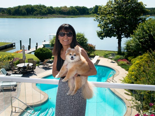 Dawn Baddock, an Animal Resource Foundation volunteer, poses with her Pomeranian dog, Lissie, at her Queen's Anne County home on June 28, 2017. Lissie was a dog rescued in a high-profile Wicomico County puppy mill case.