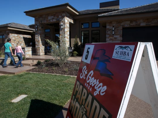 Visitors to the St. George Area Parade of Homes entry called the Secret of St. George walk through the home Monday, Feb. 16, 2015.