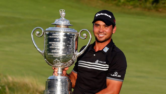 Aug 16, 2015: Jason Day poses with the Wanamaker Trophy after winning the 2015 PGA Championship golf tournament at Whistling Straits.