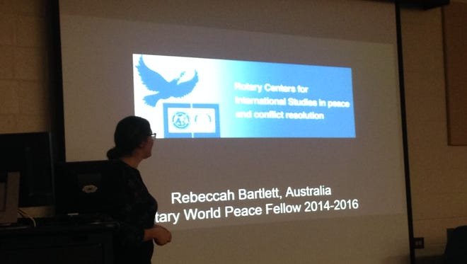 Rebecca Bartlett of Australia speaks at the Science and Philosophy Seminar on Friday, Nov. 13, about her experiences as a Rotary Peace Fellow.