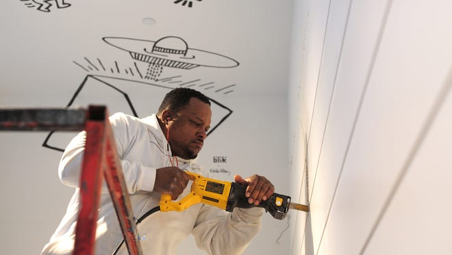 With schools no longer offering middle school shop classes, many kids don't have the opportunity to learn whether they might be interested in a construction career, John Morris writes in an op-ed. Here, Rodney Hairston with Turnbull-Wahlert Construction tears out a wall as part of renovations at Cincinnati's Contemporary Arts Center in January.