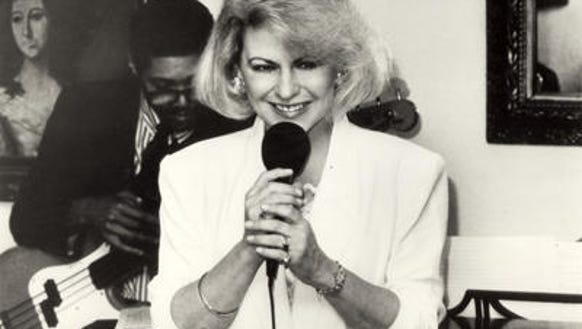 Mary Ellen Tanner holding mike