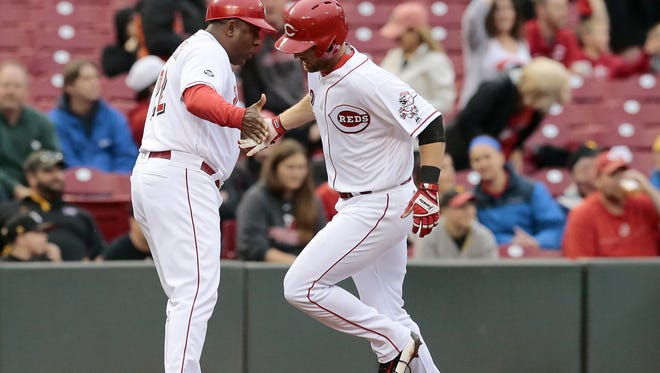 Cincinnati Reds shortstop Zack Cozart (2) rounds third base after a solo home run in the bottom of the first inning of the MLB National League game between the Cincinnati Reds and the Pittsburgh Pirates at Great American Ball Park in downtown Cincinnati on Monday, May 9, 2016.