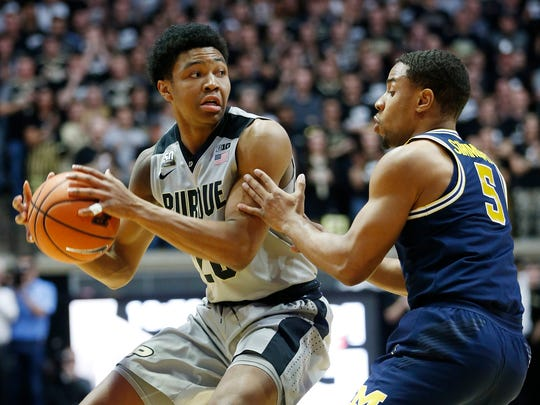 Nojel Eastern of Purdue looks to work the ball into the post past Jaaron Simmons of Michigan Thursday, January 25, 2018, at Mackey Arena. Purdue defeated Michigan 92-88.