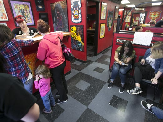 Friday the 13th tattoo piercing deals where to go in for Tattoo shops hiring front desk