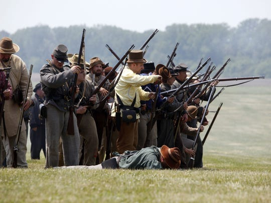 Confederate soldiers fight back during Civil War Days at Conner Prairie in 2012.