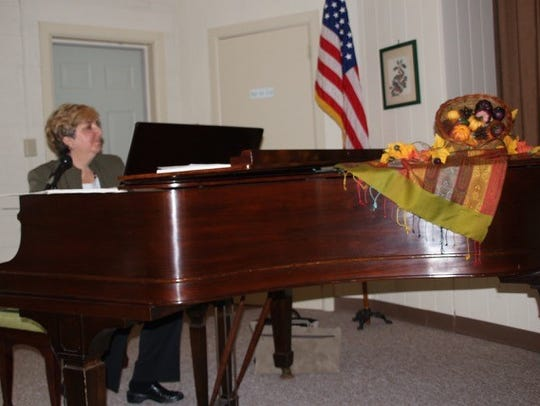 Debbi Permito, a retired Millville music teacher, provides