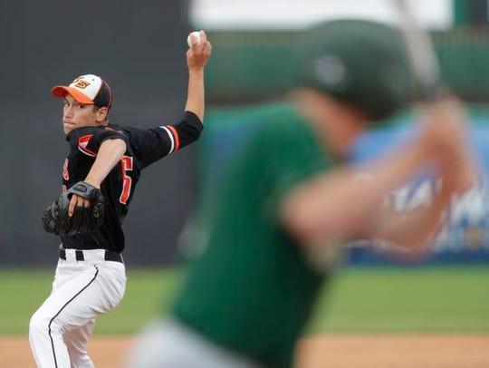 Iola-Scandinavia High School's Seth Korb (6) pitches
