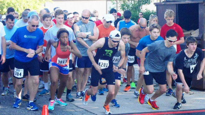 Racers break from the start line of the annual St. Vincent de Paul 5K Run for the Poor at St. Elizabeth Ann Seton Church in Milford, Ohio.