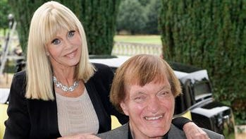 """Britt Ekland and Richard Kiel attend a photocall for the """"Bond 50"""" anniversary in London in this file photo. Kiel, the towering actor best known for portraying steel-toothed villain Jaws in a pair of James Bond films, has died. He was 74."""