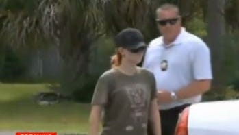 Michelle King, 25, was escorted from her Yulee, Fla., home by investigators Tuesday, July 8, 2014. King is charged with neglect after her son was left in a hot car and taken to the hospital to be treated for heat exhaustion.