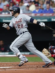 Tigers rightfielder J.D. Martinez hits a double off