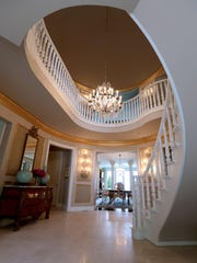 This elegantly curved staircase makes a statement in the entryway.