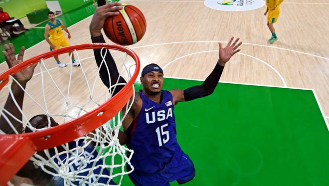 USA forward Carmelo Anthony (15) grabs a rebound against Australia during men's basketball preliminary round in the Rio 2016 Summer Olympic Games at Carioca Arena 1.