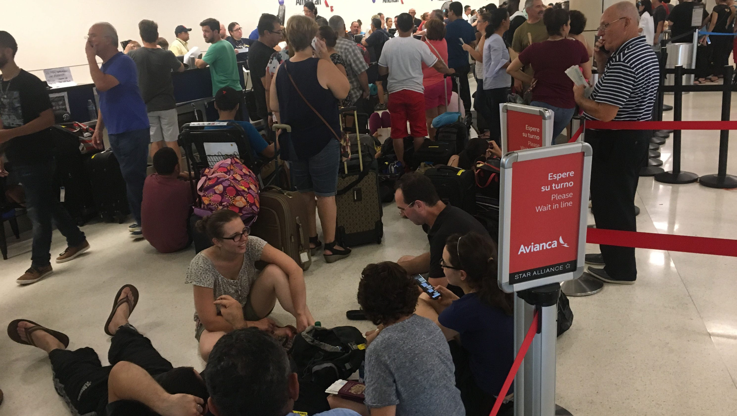 'It's like the end of the world' inside San Juan's steaming airport