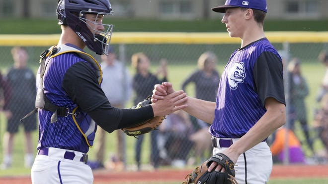 Jackson catcher Dillon Dingler and pitcher Kyle Nicolas congratulate each other after the final out against Walsh Jesuit in a Division I regional semifinal on Friday, May 26, 2017. The two former teammates are projected to be taken high in this week's Major League Baseball Draft.