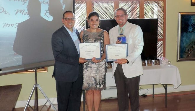 Dan Otero, HMS Chief Executive Officer, and Darrick Nelson, MD, HMS Chief Medical Officer and Family Medicine Residency Program (FMRP) Director, congratulate Magda Ramirez, MD, Family Medicine Physician, on her 2017 HMS FMRP graduation.