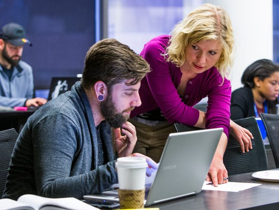 Visiting Professor of Law Julie Gunnigle helps first-year law student Timothy Rosini, 32, in the Criminal Practice and Writing II class at Arizona Summit Law School in downtown Phoenix on Feb. 28, 2017.
