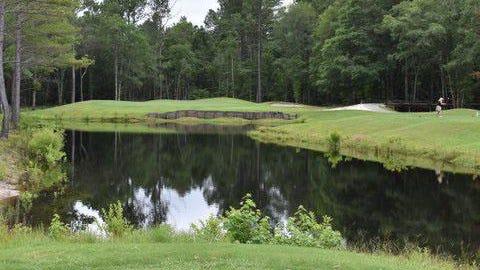 The par-3 No. 15, the signature hole at Black Creek Golf Club.