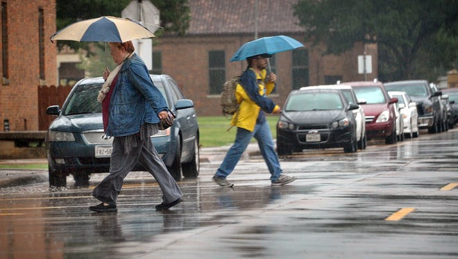 North Texans made their way to work and classes under a steady rain in many areas Tuesday morning like this scene at Midwestern State University.