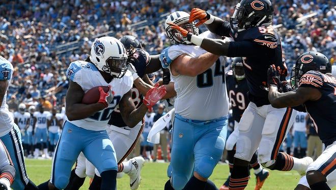 Titans running back Derrick Henry (22) goes in for the score as Titans offensive guard Josh Kline (64) clears the path in the fourth quarter of a preseason game against the Bears at Nissan Stadium Sunday, Aug. 27, 2017 in Nashville, Tenn.