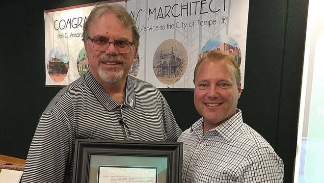 During Mark Vinson's (left) recent retirement party in recognition of 30 years and two months of service to Tempe, Mayor Mark Mitchell proclaims Mark Vinson Day in Tempe.