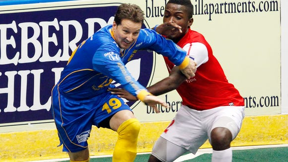 Rochester's Doug Miller, left, gets past Missouri's Robert Palmer during MISL soccer action between the Missouri Comets and the Rochester Lancers at the Blue Cross Arena in Rochester Wednesday afternoon, January 1, 2014.